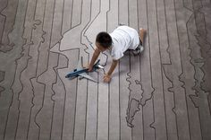 http://www.fubiz.net/2014/04/11/urban-fabric-rugs-by-four-o-nine/