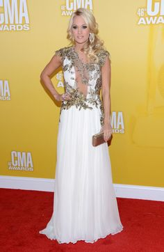 carrie underwood white dress | Country music artist Carrie Underwood attends the 46th annual CMA ...