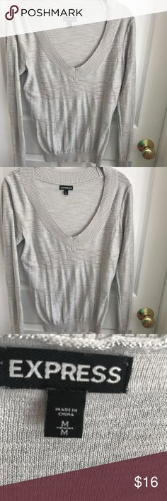 Express silver and sparkle sweater Gorgeous silver with sparkly stripe sweater. Such a classic beautiful sweater. Great used condition with minimal wear Express Sweaters V-Necks