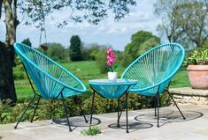 Affordable Garden Designs for Outdoor Living - Sue Ryder | Super stylish and full of modern good looks, these would look fantastic just about anywhere including indoors don't you think? The roomy cocoon-shaped chairs are inviting as well as being designed for maximum comfort. #outdoorfurniture #gardenideas #gardeninspo #contemporarygarden #furnituredesign #garden #outdoorliving #interiors #interiorinspo