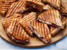 Recipe of the Day: Ina's Ultimate Grilled Cheese Ina's toasty, gooey grilled cheese comes stacked with more than just cheese. The key is slathering each slice of bread generously with a zesty blend of Dijon, mayo and Parmesan. Oh, and the addition of roasted thick-cut bacon, aged gruyère and cheddar doesn't hurt either.