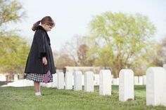 Saturday Prayer for the Souls in Purgatory: A girl in a cemetery.