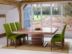The Middleton Square extending central pedestal table in solid Wild Walnut.Also available with rectangular tops.