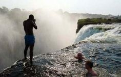"During the dry season, when the Zambezi River is at its lowest, a natural rock ledge at the very lip of Victoria Falls creates the world's highest and most dangerous infinity pool. Adventuresome swimmers can wade through the enclosed patch of water known as the ""Devil's Swimming Pool"" to the precipice of the 100-meter falls and look down upon the gorge below."