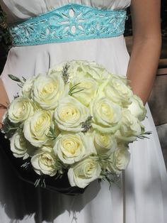 Dutch large headed white roses with sprigs of Lavender and Rosemary