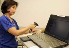 Gina Brickner scans a patient's bar code to pull up electronic records at MedCentral/Mansfield Hospital.