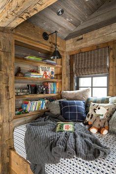 A rustic country reading nook featuring built-in shelves for books in a kids bedroom.