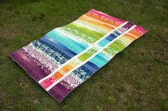 "Rainbow jellyroll quilt. Inspired by Cluck Cluck Sew  the ""Strip and Flip"" pattern."