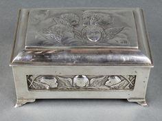 "Lot 492, An Edwardian repousse silver trinket box with Reynolds angels decoration London 1903 6"", Est £150-200"