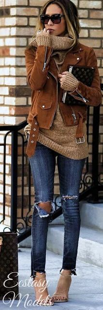 Camel moto jackets. Must. have. one. This suede moto is a gorgeous deep rust shade straight out of the 70s. She is wearing it over a lighter camel cowl neck tunic sweater with ripped knee chewed hem skinnies and light ankle strap stilettos. Style Planet #camel moto #rust moto #camel sweater tunic