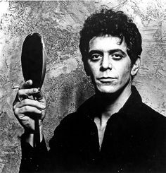 Lou Reed holds a hand mirror in a portrait dated 1970, the year in which The Velvet Underground released their fourth and final album.