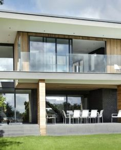 Home Design. Incredible Modern House Designs In Uk. Ar Design Studio Modern House With Open Concept Ground Floor Featuring Elegant Cantilevered First Floor And Small Tree Wall Fence Design