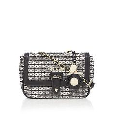 From Floozie by Frost French, this cross body bag will make a chic addition to an accessory collection. In a timeless tweed finish, this stylish piece features a gold metal logo design with a pretty heart at the magnetic popper fastening and offers a handy internal zip pocket.