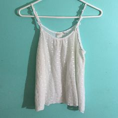 Cream/white tank top Very cute creamy white tank. Very casual and comfortable with adorable flower straps, and button accent on the back. Double layered so it's not see threw. Poetry Tops Tank Tops