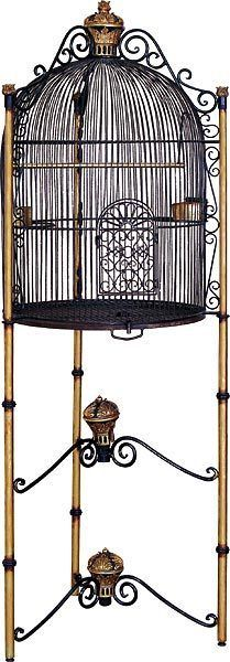 A gorgeous traditionally ornate Victorian style - royal bird cage. With all of these functional features, one would think it was engineered by a bird. The cage alone stands about high. A series of three hand-painted gold finials assist this piece.