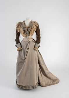 Grey silk satin and velvet day dress, trimmed with cream needle-run silk net Worth of Paris, 1891 Worn by Mary Chamberlain Fashion Museum Bath