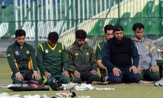 Pakistani cricketers and team batting coach Inzamam-ul Haq (3rd R) offer prayers during a team practice session at the Gaddafi stadium in Lahore on December 17, 2012.