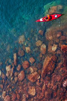 Red kayak against aqua sea; my favorite colors together.