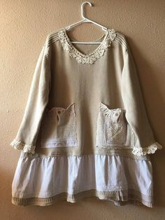 Upcycled 100% Cotton Thick Warm Oversized Sweater Pullover V-Neck with Cotton Crochet Trim. Shabby Chic Style Appliqué Vintage Crochet Doilies 2 front pockets Slightly Ruffled around the bottom Nice High Quality Thick Cotton Warm Cozy and comfortable Measured with sweater laying