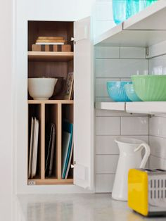 Add a divider to a cabinet to keep pans, trays, lids, utensils, baking sheets, even mail where it belongs