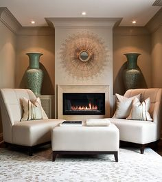Powell and Bonnell Design Inc.  Cozy reading/sitting area, probably in the Master Bedroom.  Gorgeous mirror and urns.