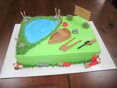 Outdoors themed retirement cake - includes fishing and hunting.