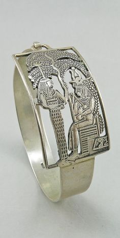 Hey, I found this really awesome Etsy listing at http://www.etsy.com/listing/167878678/art-deco-silver-bangle-egyptian-revival