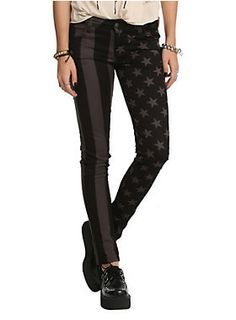 Stretchy skinny jeans with grey and black stars and stripes split leg design. Classic 5-pocket styling.