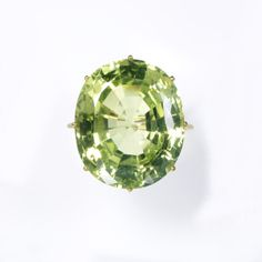 Ring of green chrysoberyl in a gold mount that dates from about 1850, probably made in London