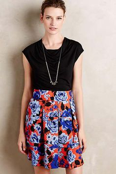 Cowled jersey tank and floral patterned skirt.