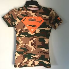 Shop Kids' Under Armour Brown Tan size MB Shirts & Tops at a discounted price at Poshmark. Description: Camo Superman Alter Ego shirt for boys by Under Armour.. Sold by remreader. Fast delivery, full service customer support.