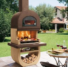 20 Modern Fireplace Design Ideas for Outdoor Living Spaces : What a great pizza oven/BBQ grill combo! Pizza Oven Outdoor, Outdoor Cooking, Parrilla Exterior, Barbecue Garden, Wood Charcoal, Build A Fireplace, Outdoor Fireplace Designs, Fireplace Seating, Four A Pizza