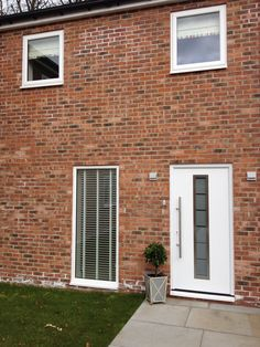 White Aluminium Front Door with Medium Sized Brushed Steel Pole Handle / Full Length Window / White Windows / Obscure Glass / Contemporary Front Door / Modern Front Door / Renovation /   http://www.nationalwindowsystems.co.uk Contact us for a quotation, 01325 381630 or via sales@nationalwindowsystems.co.uk
