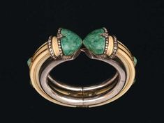 Georges Fouquet (1862-1957), silver bracelet and yellow gold, ivory, son of gold décor six cabochons jade green enamel highlighted ends of lines of rose-cut diamonds, circa 1920-1925.