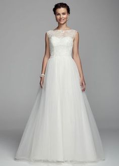 All eyes will be on you as you walk down the aisle in this stunning ball gown!  Cap sleeve tulle ball gown features ultra-feminine illusion neckline.  Bodice is adorned with beaded lace appliques.  Chapel train. Sizes 0-14.  Available in stores and onlineIvory. White available for Special Order only.  Fully lined. Back zip. Imported. Dry clean only. Available in Plus sizes as Style 9WG3672. To preserve your wedding dreams, try our Wedding Gown Preservation Kit.