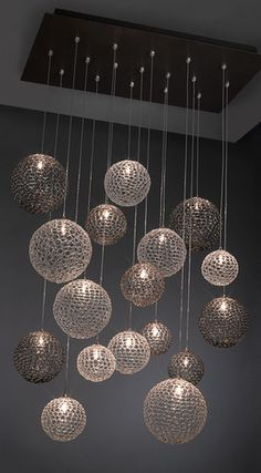 Could do this following the bubble chandelier tutorial but make the rattan like balls instead?