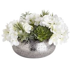 For a functional centerpiece that arrests attention, you've come to the right place. Handcrafted exclusively for Pier 1, our mix of white hydrangeas and verdant succulents in an organically shaped, textured vase boasts a metallic finish that reflects beautifully on its surroundings.