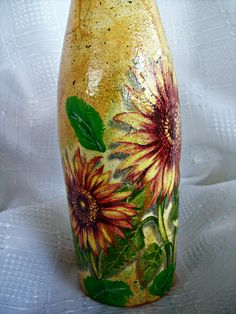 Hand painted & napkin decoupage on the bottle  This bottle has been lovingly hand painted with fine art quality acrylic and napkin decoupage sunflowers . Bottle capacity 0.7 liter  Original and unique!  My bottles are finished with protection waterproof varnish and are fade and moisture resistant, can be used, can be washed but not dishwasher  Your little works of art will arrive carefully packaged.