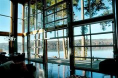 want a glass wall? Install Avante glass garage doors from Clopay - For the lake house.