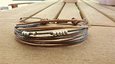 Beautiful Handmade Bracelet in Blue and Brown. Adjustable and Pretty bracelet for Everyone. by Bohemicin on Etsy