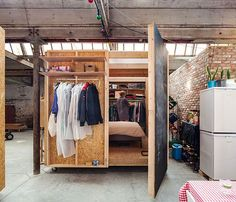 Wooden-box-containing-the-temporary-bedroom-inside-the-factory