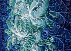 Stallman takes strips of painted canvas and balances it on its edge, creating looping, swirling scrollwork that becomes an abstract image.