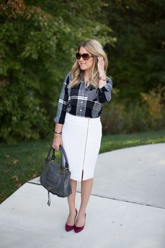 An edgy zipper adds a unique detail to an otherwise basic pencil skirt, and paired with plaid it is perfect for a fall workday...click through for more fall work outfits!