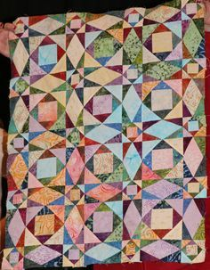 Storm At Sea by Mary Evans Mary started this lovely quilt in Midway. A beautiful place to begin a beautiful quilt.   Sea Of Blue by Mary ...