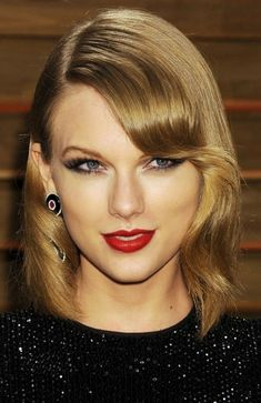 Taylor Swift - love the liner work on the inner corner. By drawing the liner down in the inner corner and winging it up in the outer corner, you get a seriously sexy cat eye shape further emphasized by the highlight on the tear duct.  The skin is contoured but still fresh, making the red lip a perfect counter point to the dramatic eye.