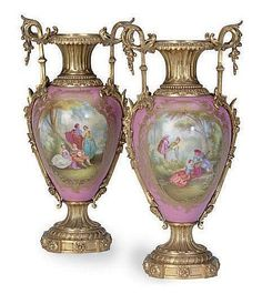 A PAIR OF GILT METAL-MOUNTED SEVRES STYLE PINK-GROUND VASES, <br />LATE 19TH/20TH CENTURY, <br />painted with courting couples, and musical trophies to the reverse <br />13½in. (34.3cm.) high (2)<br />