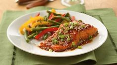Toasted sesame seeds, sweet apricot preserves, and fresh gingerroot add depth to a classic salmon dish.