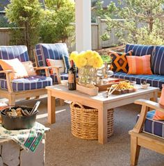 Pulling all the furniture up to a coffee table outside does the same trick as indoor seating arrangments—facilitates conversation. The oversize basket under the coffee table provides convenient storage for throws for when there is a chilll in the air.