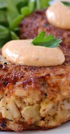 Maryland Crab Cakes with Horseradish-Sriracha Remoulade ~ These crab cakes use hardly any filler for the best crab flavor, are seasoned with Old Bay, and are topped with a delicious Horseradish-Srirac (Crab Cake Recipes) Fish Dishes, Seafood Dishes, Fish And Seafood, Seafood Recipes, Cooking Recipes, Healthy Recipes, Seafood Platter, Vegetarian Recipes, Bonefish Grill Recipes