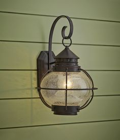 Scaled for big impact, this 1 ½ -foot tall lantern makes a bold statement, especially when flanking a double doorway. About $140; maximlight.com